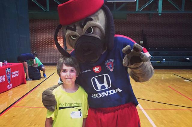 Mega Kids Camp kid with Indy Eleven mascot