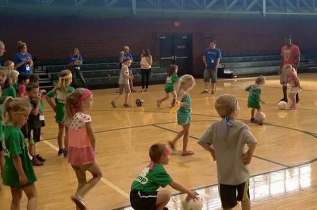 Mega Kids Camp kids playing soccer